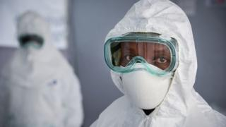 A health worker is seen wearing Personal Protective Equipment (PPE) during a rehearsal at the Bwera General Hospital close to Uganda's border with DR Congo in December 2018.