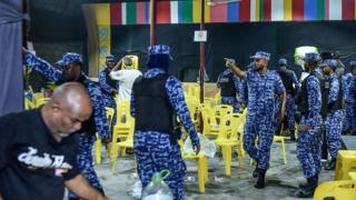 Maldivian police entering the main opposition Maldivian Democratic Party (MDP) camp to break up celebrations of opposition supporters on 2 February 2018