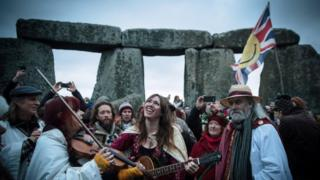 Thousands of people gathered at Stonehenge in Wiltshire to watch the sun rise on the shortest day of the year.