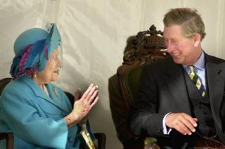 Queen Mother sharing a joke with her grandson the Prince of Wales