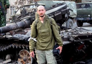 Arkady Babchenko posing in front of Georgian Army tank wreckage in Tskhinvali, South Ossetia - 2008