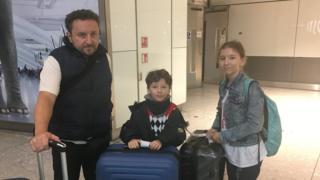 Daniel Maloney and children Freddie and Isabella at Heathrow airport