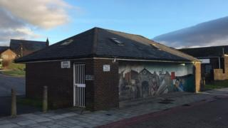 A disused public toilet decorated with a colourful mural in North Street, Dowlais