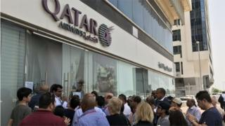 Crowd outside Qatar Airways office
