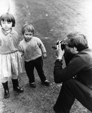 Robert Blomfield photographing two children, taken by his wife Jane.
