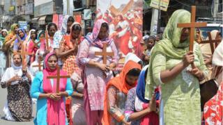 Indian Christian devotees carry wooden crosses in Amritsar