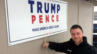 Business owner Rick Coombs and his sign