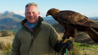 Countryfile Winter Diaries presenter with a golden eagle.