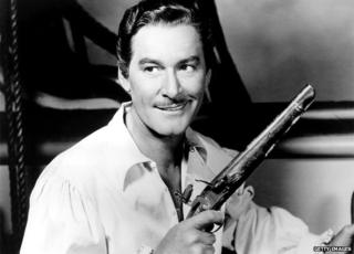 Errol Flynn looking dashing and a bit of a cad