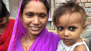 A Bihari woman holds her child