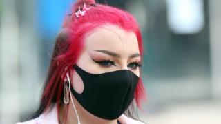 Belfast shopper wearing face mask