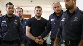 Yosef Haim Ben David (C) is led into the court in Jerusalem (3 May 2016)