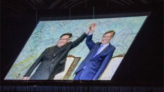 "An image of North Korea""s leader Kim Jong Un and South Korea""s President Moon Jae-in is projected during a ""Mass Games"" artistic and gymnastic display"