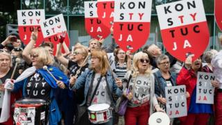 People demonstrate to support the Polish Supreme Court Justice president in front of the Supreme Court building, on July 4, 2018 in Warsaw