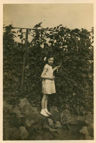 Jean Garner as a child in an allotment