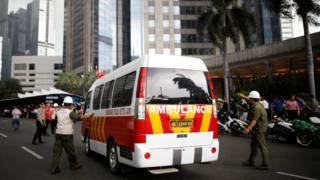An ambulance arrives at the Indonesian Stock Exchange building following reports of a collapsed structure inside the building in Jakarta