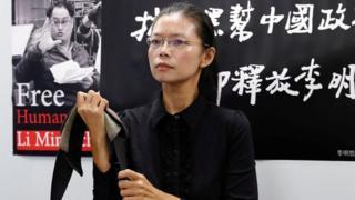 李明哲妻子李凈瑜9月9日召開行前記者會。