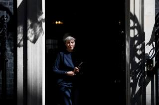 Britain's Prime Minister Theresa May prepares to speak to the media outside 10 Downing Street in central London