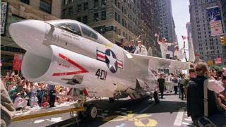 A Navy jet is pulled down Broadway Avenue in a June 1991 welcome home parade for returning Gulf War troops