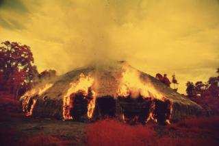 The Yanomami burn down their malocas when they migrate, if they want to get rid of a plague or if an important leader dies. Taken with infrared film in 1976