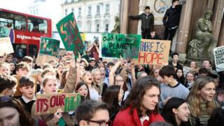 Schoolchildren take part in a student climate march on February 15, 2019 in Brighton, England.