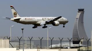 Etihad Airways plane prepares to land at the Abu Dhabi airport in the United Arab Emirates