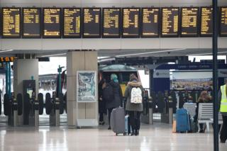Passengers view the departures boards at Leeds train station just before 9.00am on the day after Prime Minister Boris Johnson put the UK in lockdown to help curb the spread of the coronavirus