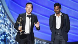 Actor/writer Aziz Ansari (R) and writer Alan Yang (L) accept Outstanding Writing for a Comedy Series for the 'Master of None' episode 'Parents' onstage