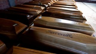 Coffins inside a cemetery chapel in the town of Serravalle