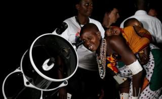 A Maasai woman uses a telescope to witness the rise of the supermoon in Oloika village in Shompole, Magadi near the Kenya-Tanzanian border, November 14, 2016.