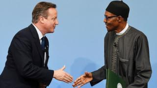 David Cameron (L) greets Nigerian President Muhammadu Buhari during the Anti-Corruption Summit London 2016, at Lancaster House in central London on May 12, 2016