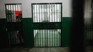 An inmate stands in the Anisio Jobim penitentiary complex on February 17, 2016 in Manaus, Brazil.