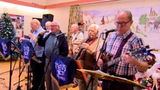 Members of Men's Shed Antrim performing
