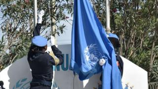 Senegalese police officers of di UN Formed Police Unit as dem dey raise di UN flag for opening ceremony of United Nations Mission for Haiti