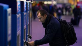Man at ticket machine