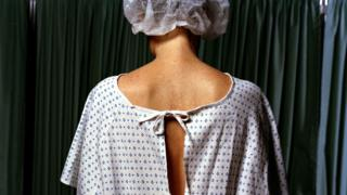 A woman in a surgical gown