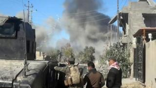 Smoke rises following a US-led coalition air strike in Ramadi on 25 December 2015.