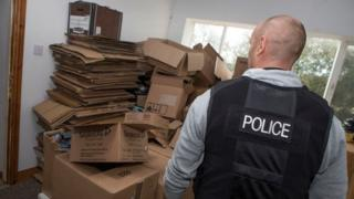 Boxes which held drugs stacked up