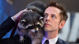 Oreo the raccoon and director James Gunn
