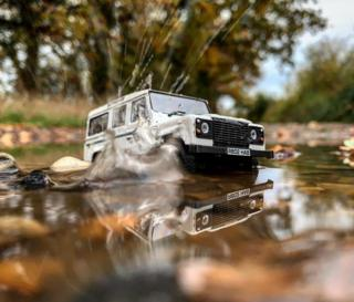 in_pictures White model Land Rover splashes through puddle
