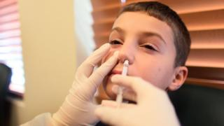 A child having the flu vaccine