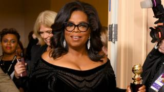 Oprah Winfrey smiles for the cameras after her Golden Globe speech.