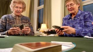Two ladies playing bridge