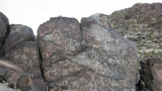 Petroglyphs on a rock face in Samalayuca