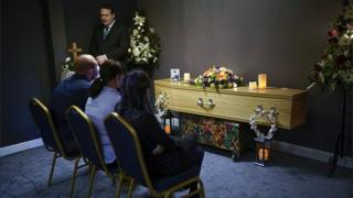 Mourners at a funeral