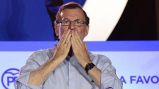 Leader of the Popular Party (PP) and Spain's caretaker Prime Minister Mariano Rajoy blows kisses to his supporters at the PP headquarters during Spain's general election in Madrid on 26 June 2016.