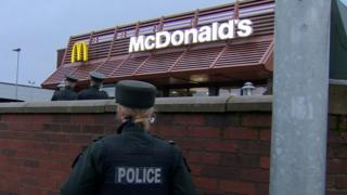 Police officers at McDonalds on Glenmachan Street in Belfast