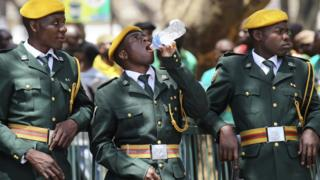 Zimbabwean soldiers relax during the opening of the 4th session of the 8th Parliament of Zimbabwe in Harare, Thursday, Oct, 6, 2016. (AP Photo/Tsvangirayi Mukwazhi)