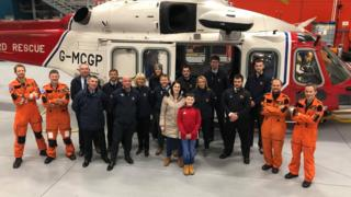 Keiran Reid with RNLI volunteers and Coastguard personnel
