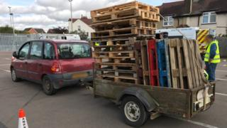 pallets on the back of a car